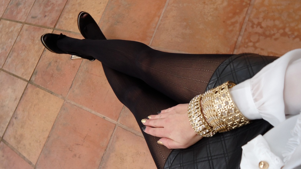 Opulent Arm Party With A Gold and Black Mani To Match