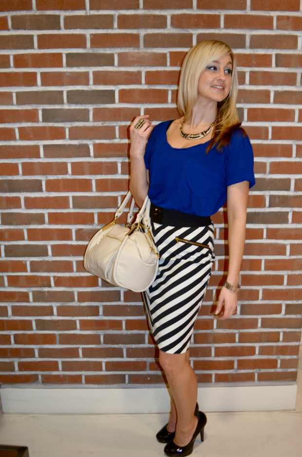 Wearing mark. High Contrast Skirt, mark. Classic Hit Handbag, mark. Jewelry and Express Tee