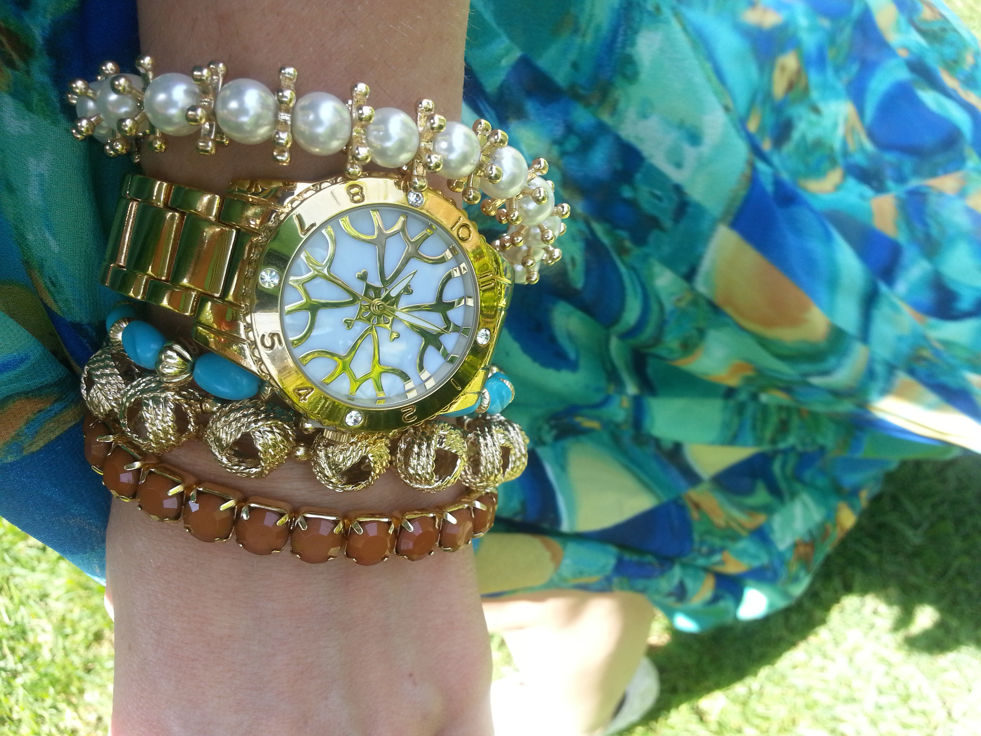 Arm Party with mark. Glimmer and Gleam Bracelets and Avon Signature Watch