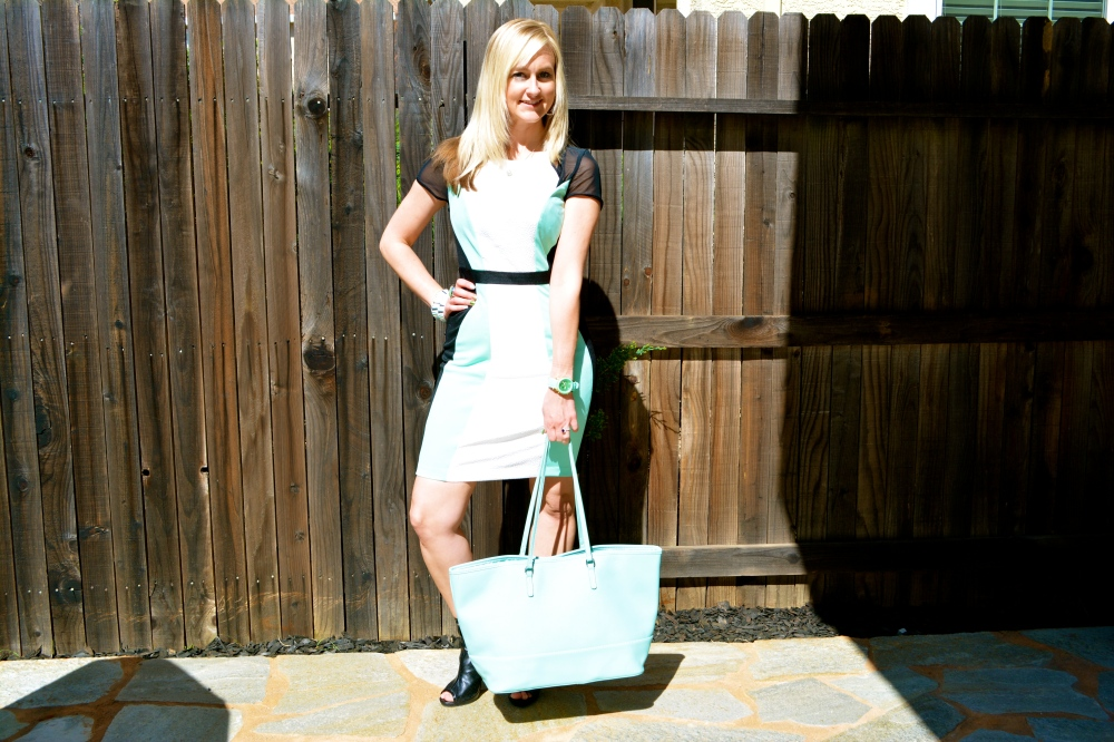 Wearing mark. Major Hit Dress, Wave Me On Bracelet, Bold Move Bootie and Avon Classic Carry All Tote
