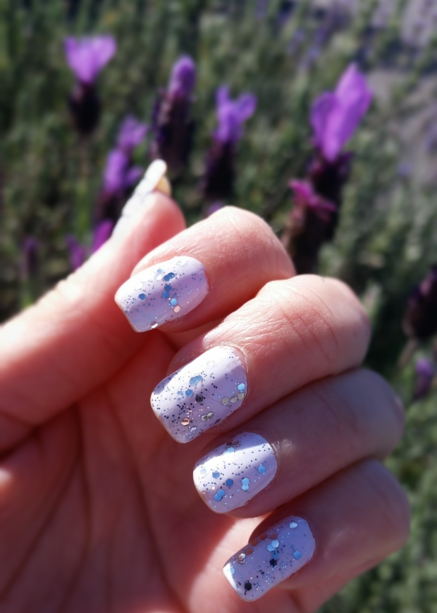 Creamy white mani with dazzling glitter topcoat!