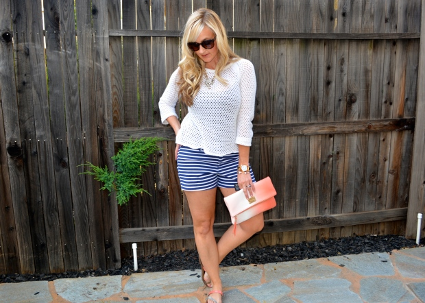 Nautical look with a beach sweater and navy striped shorts.
