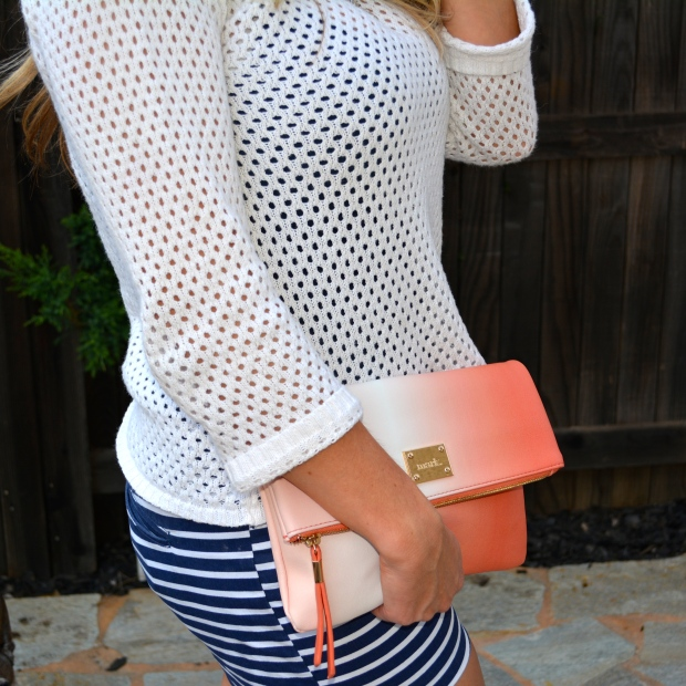 Pairs perfectly with nautical shorts and coral ombre clutch.