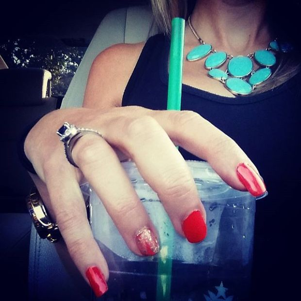 #mynailsandmydrink in orange and gold and a casualty