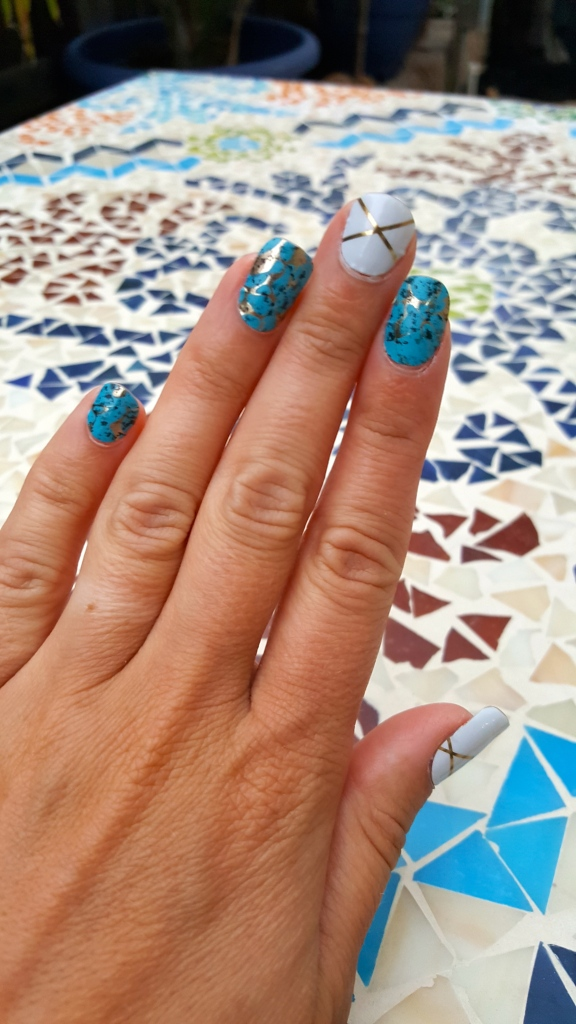 Jamberry Turquoise with Gatsby on middle and thumb